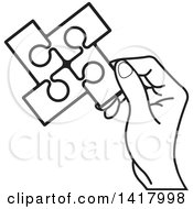 Poster, Art Print Of Lineart Hand Holding A Section Of Connected Jigsaw Puzzle Pieces