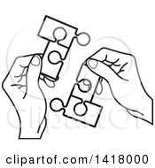 Clipart Of Lineart Hands Holding Connected Jigsaw Puzzle Pieces Royalty Free Vector Illustration by Lal Perera