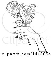 Clipart Of A Black And White Womans Hand Holding Flowers Royalty Free Vector Illustration