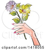 Womans Hand Holding Flowers