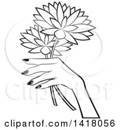 Black And White Womans Hand Holding Flowers