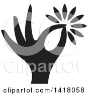 Clipart Of A Black Hand Holding A Flower Royalty Free Vector Illustration