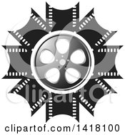 Clipart Of A Silver Black And White Film Reel Design Royalty Free Vector Illustration