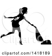 Clipart Of A Black Silhouetted Female Maid With A Pony Tail Vacuuming Royalty Free Vector Illustration by Pams Clipart