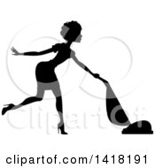 Clipart Of A Black Silhouetted Female Maid With Short Hair Vacuuming Royalty Free Vector Illustration