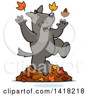 Cartoon Clipart Of A Happy Wolf Playing In Autumn Leaves Royalty Free Vector Illustration