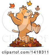 Cartoon Clipart Of A Happy Ginger Cat Playing In Autumn Leaves Royalty Free Vector Illustration