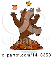 Cartoon Clipart Of A Happy Bear Playing In Autumn Leaves Royalty Free Vector Illustration