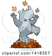 Cartoon Clipart Of A Happy Rhino Playing In Autumn Leaves Royalty Free Vector Illustration