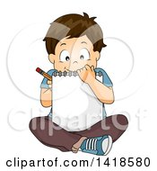 Brunette Caucasian School Boy Sitting On The Floor And Sketching In A Notebook
