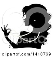 Clipart Of A Black Silhouetted Woman Wearing Pearl Earrings And A Ring And Playing With A Necklace Royalty Free Vector Illustration