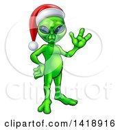 Green Alien Wearing A Christmas Santa Hat And Waving