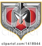 Clipart Of A Retro Spartan Helmet Over A Silver And Red Shield Royalty Free Vector Illustration by patrimonio