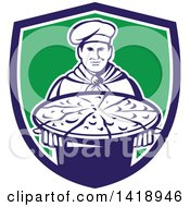 Retro Male Chef Holding A Pizza Pie On A Blue White And Green Shield