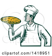 Retro Woodcut Male Chef Holding A Pizza Pie