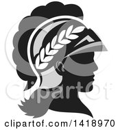Clipart Of A Grayscale Profile Portrait Of The Roman Goddess Of Wisdom Minerva Or Menrva Wearing A Helmet And Laurel Crown Royalty Free Vector Illustration by patrimonio
