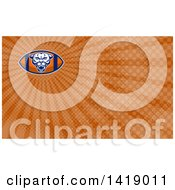 Clipart Of A Retro Fierce Mountain Lion Puma Cougar Face On An American Football And Brown Rays Background Or Business Card Design Royalty Free Illustration by patrimonio