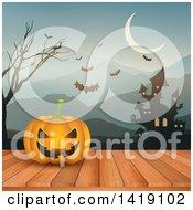 Halloween Jackolantern Pumpkin On A Deck Against A Haunted Castle Mountains And Bats