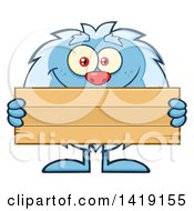 Cartoon Yeti Abominable Snowman Holding A Blank Wood Sign