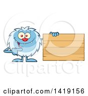 Cartoon Yeti Abominable Snowman Pointing To A Blank Wood Sign