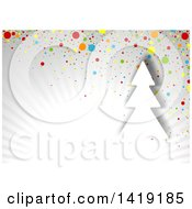 Christmas Background With A Tree Over Gray Rays With Colorful Dots
