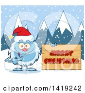 Cartoon Yeti Abominable Snowman Wearing A Christmas Santa Hat And Pointing To A Merry Christmas Sign