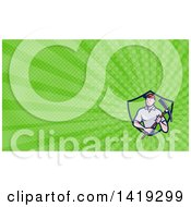 Clipart Of A Retro Cartoon Male Construction Worker Holding A Pickaxe And Green Rays Background Or Business Card Design Royalty Free Illustration