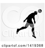 Clipart Of A Black Silhouetted Male Soccer Player Head Passing A Ball Over Gray Royalty Free Vector Illustration