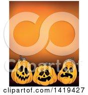 Clipart Of A Halloween Background Of Jackolantern Pumpkins Over Orange Royalty Free Vector Illustration
