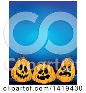 Clipart Of A Halloween Background Of Jackolantern Pumpkins Over Blue Royalty Free Vector Illustration