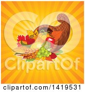 Clipart Of An Autumn Harvest Cornucopia Over Orange Sun Rays Royalty Free Vector Illustration