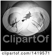 Clipart Of A Silhouetted Witch Flying On A Broomstick Over A Full Moon With Bare Branches Royalty Free Vector Illustration