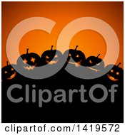 Clipart Of A Silhouetted Hill With Halloween Jackolantern Pumpkins Over Orange Royalty Free Vector Illustration by KJ Pargeter