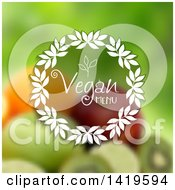 Clipart Of A Vegan Menu Text Wreath Over Blurred Fruit Royalty Free Vector Illustration by KJ Pargeter