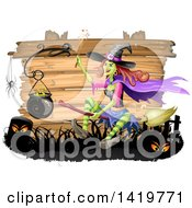 Clipart Of A Halloween Witch Flying On A Broomstick By A Cauldron Over Wood Boards Royalty Free Vector Illustration by merlinul