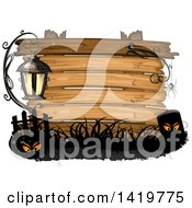 Clipart Of A Wood Sign With A Lamp Eyes Spider And Tombstone Royalty Free Vector Illustration by merlinul