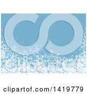 Christmas Or Winter Background With Snow And Snowflakes On Blue