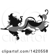 Clipart Of A Black And White Silhouetted Cat And Flying Witch Royalty Free Vector Illustration