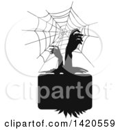 Clipart Of A Black And White Silhouetted Spider Web And Zombie Hands Royalty Free Vector Illustration