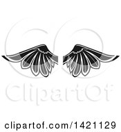 Clipart Of A Pair Of Black And White Feathered Wings Royalty Free Vector Illustration by Vector Tradition SM