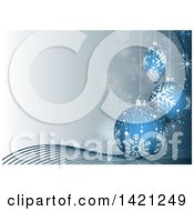 Christmas Background Of Snowflakes Waves And 3d Blue Baubles