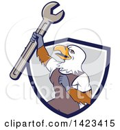 Clipart Of A Cartoon Bald Eagle Mechanic Man Holding Up A Spanner Wrench In A Blue White And Gray Shield Royalty Free Vector Illustration