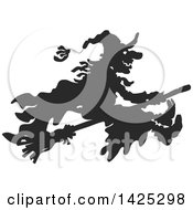 Clipart Of A Black Silhouetted Halloween Witch Flying On A Broomstick Royalty Free Vector Illustration by Alex Bannykh