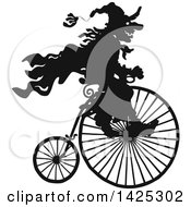 Clipart Of A Black Silhouetted Halloween Witch Riding A Penny Farthing Bicycle Royalty Free Vector Illustration by Alex Bannykh