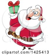 Clipart Of A Cartoon Santa Holding Up A Christmas Gift Royalty Free Vector Illustration