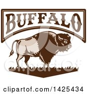 Clipart Of A Retro Woodcut Brown And Tan American Bison On Grass Under Buffalo Text Royalty Free Vector Illustration