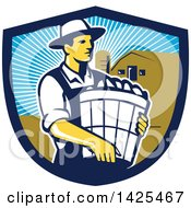 Retro Male Organic Farmer Carrying A Bushel Of Harvest Produce In A Shield Against A Barn And Silo
