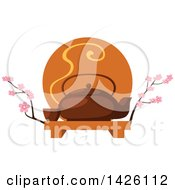 Japanese Ta Pot With A Cup On A Tray With Cherry Blossom Branches