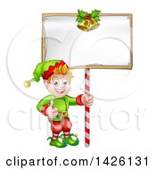 Clipart Of A Cartoon Happy Male Christmas Elf Giving A Thumb Up And Holding A Blank Sign With Bells Royalty Free Vector Illustration by AtStockIllustration