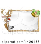 Clipart Of A Happy Christmas Reindeer Pointing Around A Sign Board With Bells Royalty Free Vector Illustration by AtStockIllustration